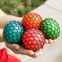 Игрушка антистресс шарик (мячик) лизун в сетке