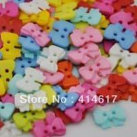 Пластмассовые разноцветные пуговицы бантики в наборе