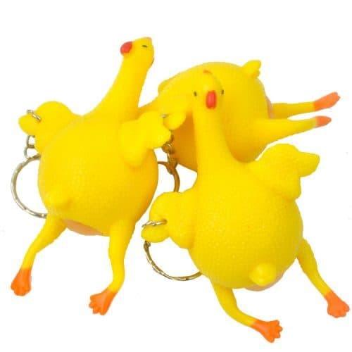 Брелок-антистресс резиновый игрушка курица, несущая яйцо