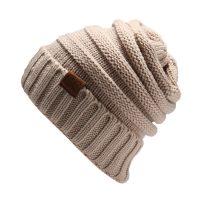 Женская вязаная теплая зимняя шапка с отворотом