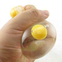 Игрушка антистресс в виде яйца (белок с желтком)