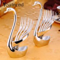 Серебристая металлическая подставка для столовых приборов в виде лебедя