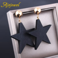 Женские висячие серьги с деревянными черными звездами