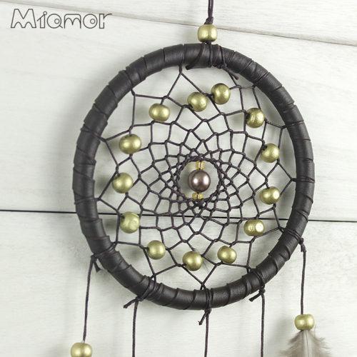 Ловец снов декор с перьями и колокольчиками в индийском стиле на стену