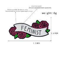 Значок брошь с розами и надписью FEMINIST