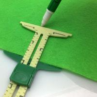 Швейный измерительный инструмент с бегунком